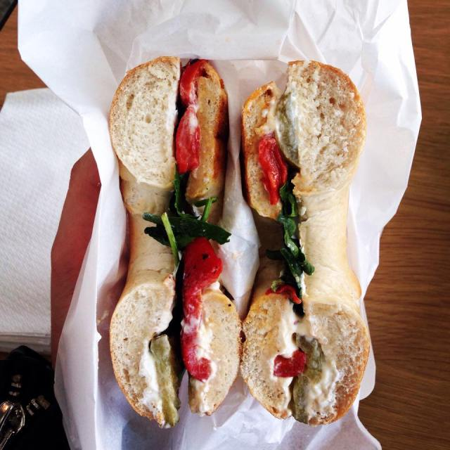 Spinach, cream cheese, red pepper and gherkin bagel. Photographer: Adrianna Anastasides.